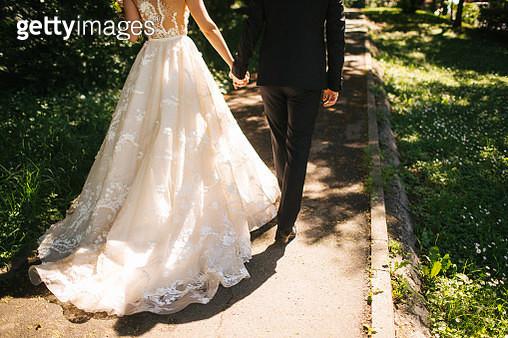Bride and groom walking on pavements - gettyimageskorea