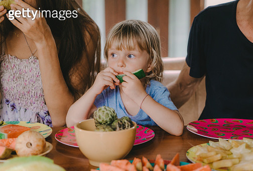 Family eats  tropical fruits on patio - gettyimageskorea