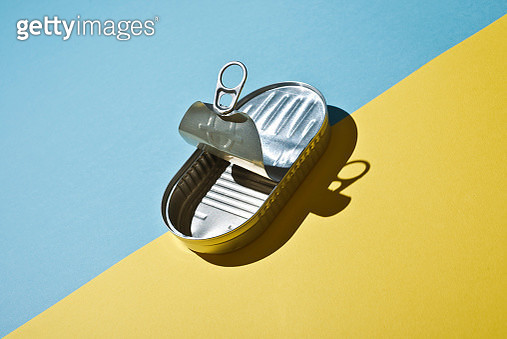 Empty sardine can On colored paper background. Clean and ready to be recycled - gettyimageskorea