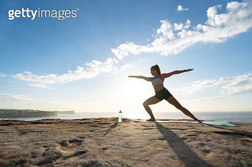 Beautiful woman doing yoga exercises - gettyimageskorea