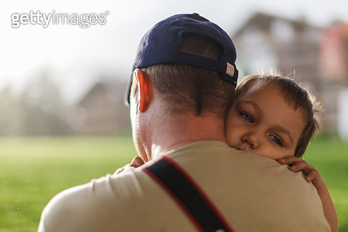 Father holding toddler in arms - gettyimageskorea
