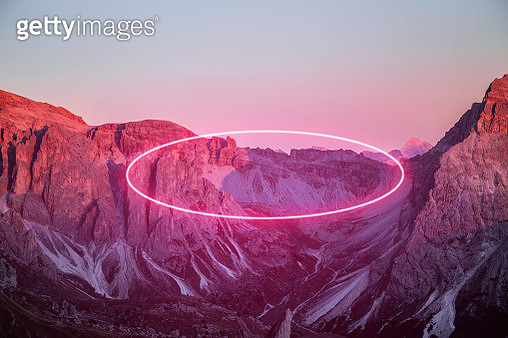Stunning circle made with neon light performing in the Alps mountains. - gettyimageskorea