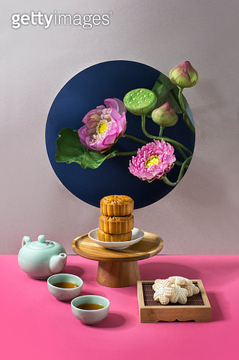 Mid autumn tea time with moon cake and Lotus blossoms on coloured shapes background. - gettyimageskorea
