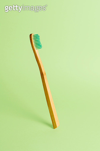 Floating Bamboo Toothbrush On A Green Background - gettyimageskorea