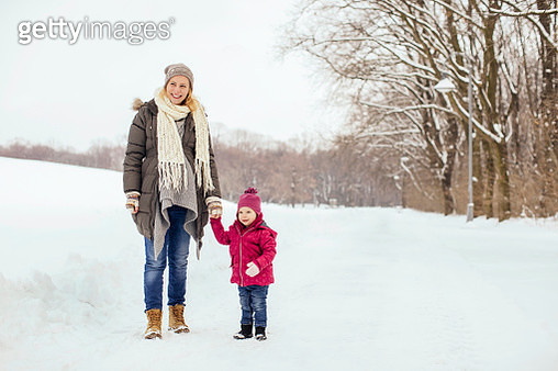 Pregnant mom and kid taking a walk togther - gettyimageskorea