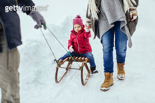 Parents and kid on the snow - gettyimageskorea