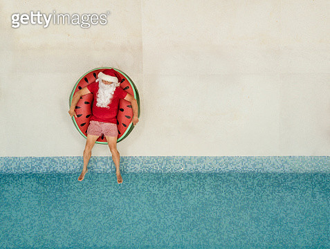 Santa Claus relaxing at the pool - gettyimageskorea