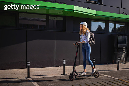 Beauty rides push scooter at sunset after work - gettyimageskorea