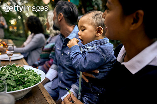 Mother with baby and other guests on a garden party - gettyimageskorea
