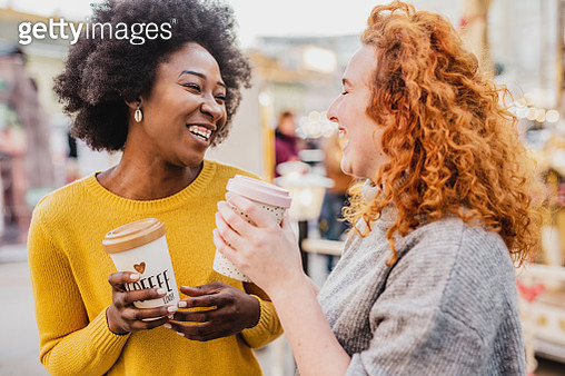 Photo of two female friends on the street holding reusable coffee cups - gettyimageskorea