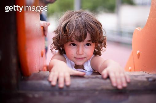 Boy on top of the slide - gettyimageskorea