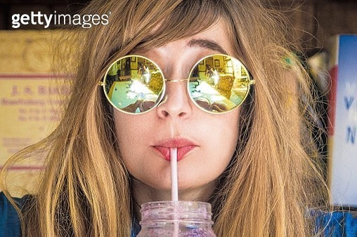 Close-Up Of Woman Drinking - gettyimageskorea