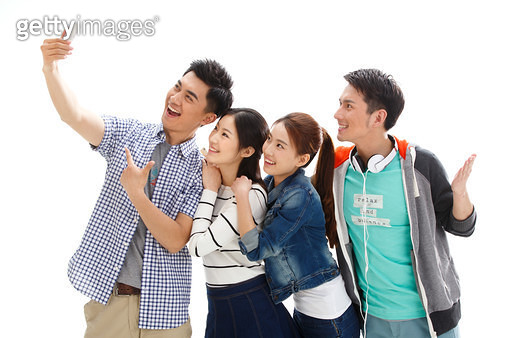 Four college students using mobile phones - gettyimageskorea