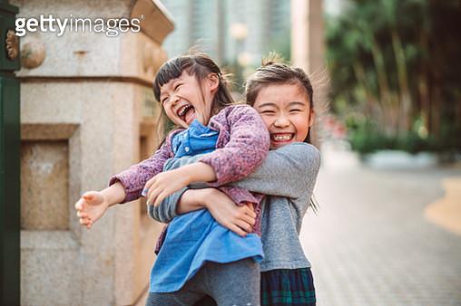 Lovely little sibling playing joyfully in promenade - gettyimageskorea