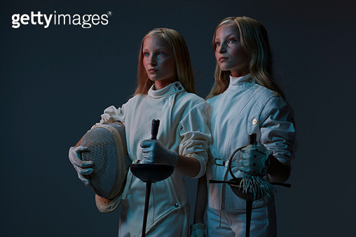Portrait of 2 young twin fencers looking out - gettyimageskorea