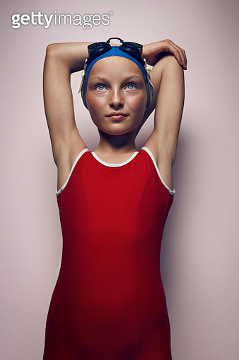 Portrait of cool young female swimmer stretching - gettyimageskorea