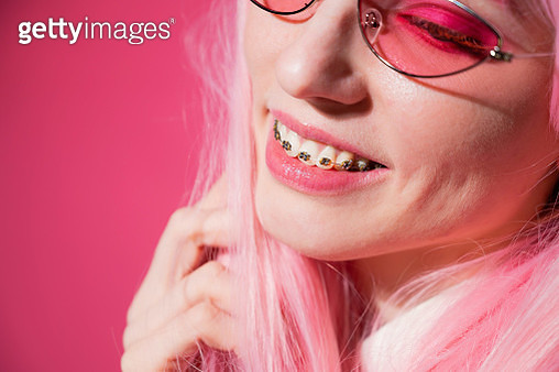 Close-Up Of Woman Wearing Braces Against Colored Background - gettyimageskorea