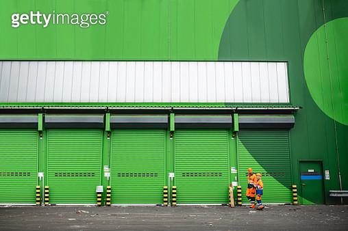 Workers Walking in Recycling Facility Loading Dock Area - gettyimageskorea