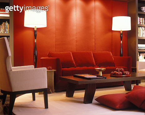 Red velvet couch and padded wall in modern living room - gettyimageskorea