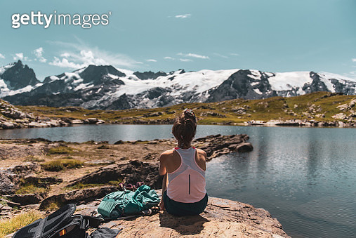 Young woman hiking in French Alps in summer during the day - gettyimageskorea