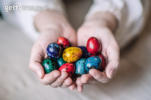 Young woman's hands with colourful Easter eggs - gettyimageskorea