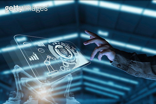 Businessman pointing at hologram with icon on virtual screen, Smart factory technology interface - gettyimageskorea