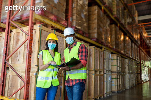 Warehouse worker wearing protective mask to Protect Against Covid-19 - gettyimageskorea