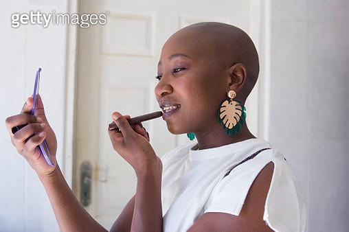 Woman putting on lipstick - gettyimageskorea