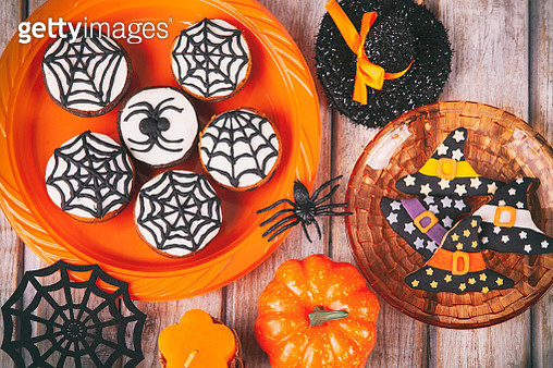 Halloween party with homemade gingerbread cookies on white rustic wooden table - gettyimageskorea