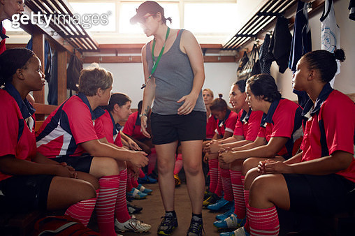Coach prepping rugby team before game - gettyimageskorea