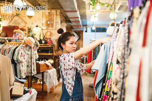 Young woman shopping in a vintage clothing store - gettyimageskorea