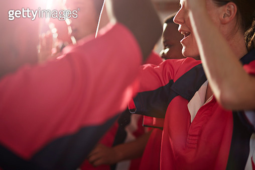 Close-up of rugby team cheering after game - gettyimageskorea