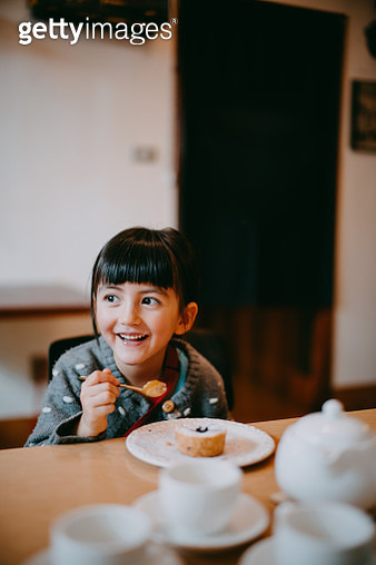 Cute mixed race preschool girl enjoying cake - gettyimageskorea