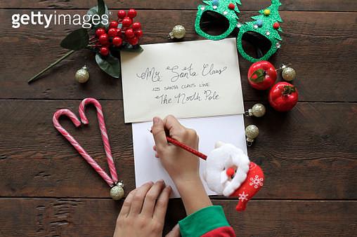 Boy writing letter to Santa - gettyimageskorea