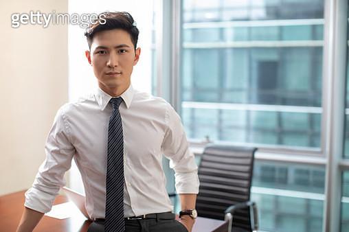 Confident businessman in office - gettyimageskorea