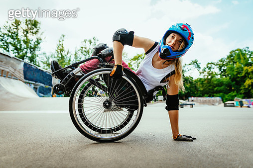 Disabled woman in wheelchair doing stunts in skate park after lockdown - gettyimageskorea