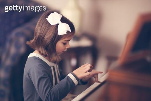 Girl playing piano - gettyimageskorea