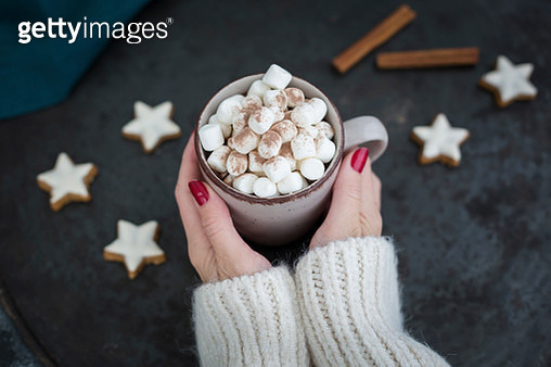 Woman's hands holding cup of Hot Chocolate with marshmellows at Christmas time - gettyimageskorea