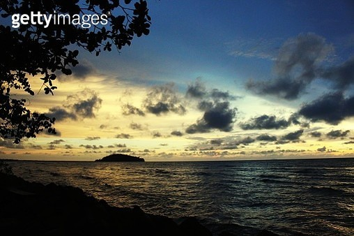 Scenic View Of Sea Against Sky At Sunset - gettyimageskorea
