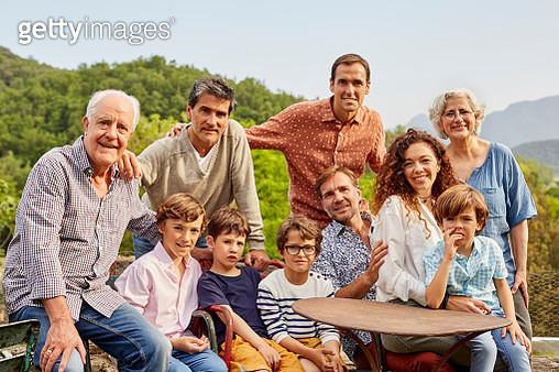 Portrait of multi generation family in yard - gettyimageskorea
