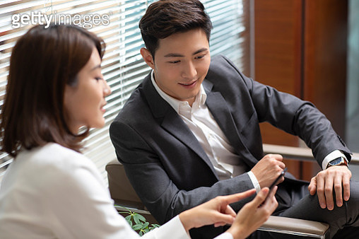 Business people using smartphone in office - gettyimageskorea