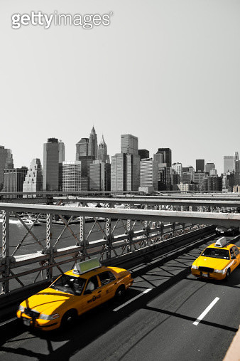Yellow taxi cabs on Brooklyn bridge by day - gettyimageskorea