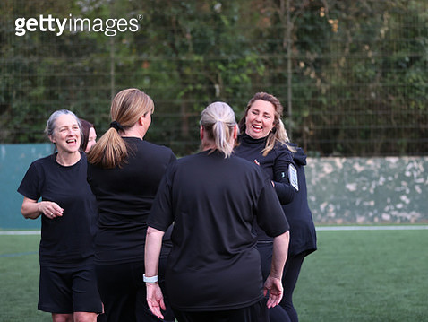 Female soccer players interacting on soccer pitch - gettyimageskorea