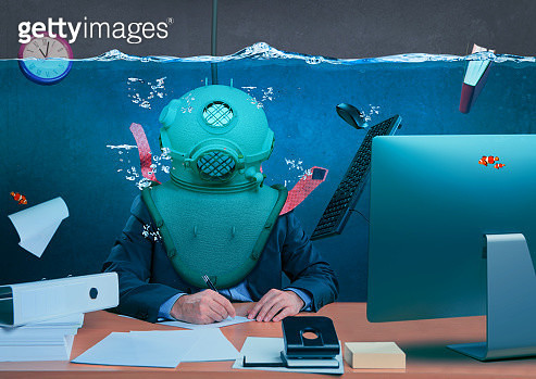 Digital Composite Image Of Businessman Wearing Oxygen Mask While Working Underwater In Office - gettyimageskorea
