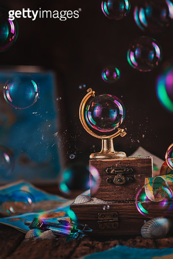 Soap bubble in a glove frame. Ecology, saving the environment and global warming concept. Metaphor in a still life with copy space - gettyimageskorea