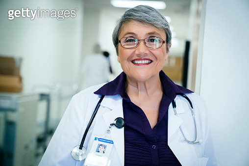 Portrait of smiling mixed race doctor - gettyimageskorea