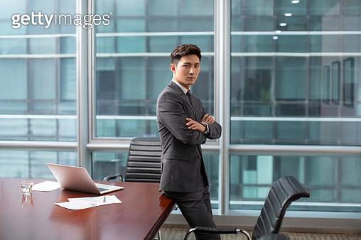 Confident businessman in meeting room - gettyimageskorea