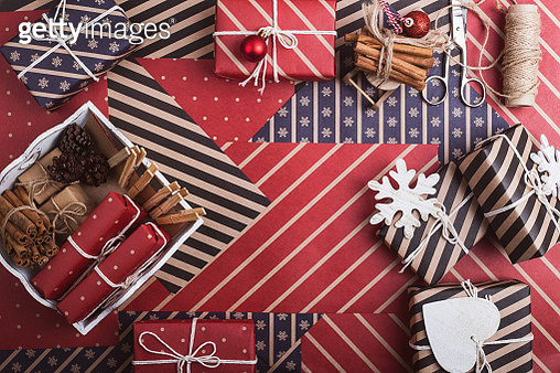 Homemade wrapped christmas gift boxes with tools and decorations - gettyimageskorea
