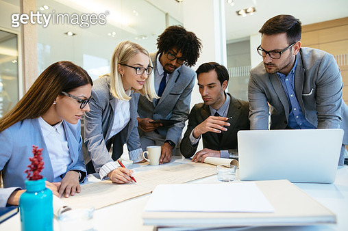 Successful business team working on a project in the office - gettyimageskorea