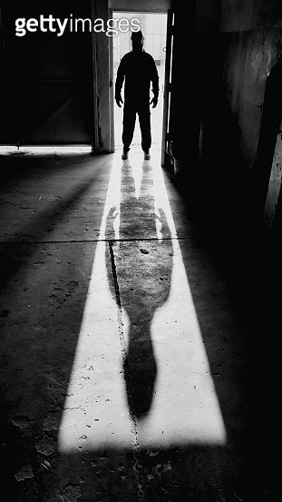Silhouette Man Standing In Doorway - gettyimageskorea